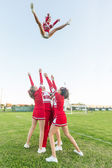 Group of Cheerleaders Performing Stunts — Stock Photo