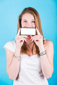 Smiling Girl Holding Smartphone with Blank Screen — Stock Photo