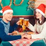 Young Couple Enjoying Christmas Dinner — Stock Photo