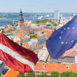 Stock Photo: Latviand EuropenFlags with RigCityscape on Background