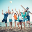 Group of Friends Playing with Ball at Beach — Stock Photo #38168607