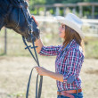 Stock Photo: Cowgirl with Black Stallion Horse