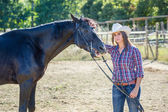 Cowgirl with a Black Stallion Horse — Foto Stock