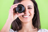 Woman Looking Through Photographic Lens — Stock fotografie