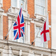 UK and England Flags on a Building Facade — Stock Photo