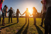 Multiracial Young People Holding Hands in a Circle — Stock Photo