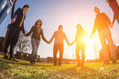 Multiracial Young People Holding Hands in a Circle — Stockfoto