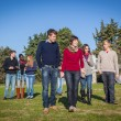 College Students Walking and Talking at Park — Stock Photo #38814513