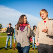 Stock Photo: College Students Walking and Talking at Park