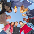 Multiracial People Holding Hands in a Circle, Low Angle View — Stock Photo