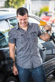 Desperate Man Using Fuel Pump as Gun — Stockfoto