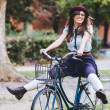 Old Fashioned Woman Riding Bicycle at Park — Stock Photo #39935055