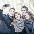 Group of Friends taking Self Portraits with Mobile Phone — Stock Photo #39937467