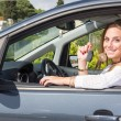 Happy Young Woman Showing Car Key — Stock Photo