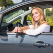 Happy Young Woman Showing Car Key — Stock Photo #39938555
