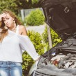 Stock Photo: Young Womwith Damaged Car