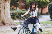 Old Fashioned Woman Riding Bicycle at Park — Стоковое фото