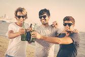 Group of Boys Cheering at Beach — Stock Photo