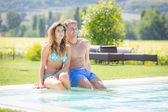 Beautiful Young Couple Next to Swimming Pool — Stock Photo