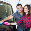 Young Couple Washing Car Together — Stock Photo