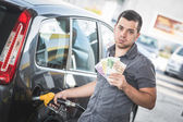 Man with Banknotes at Gas Station — Stock Photo