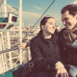 Young Couple having a Ride on a Ferris Wheel — Stock Photo #42020929