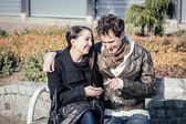 Young Couple Using Mobile Phone — Stock Photo