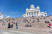 Tourists in front of Lutheran Cathedral in Helsinki — Stock Photo