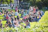 Young people resting at park — Stock Photo