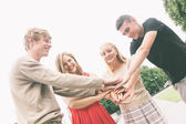 Group of Friends with Hands on Stack — Stock Photo