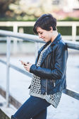 Girl Typing on Mobile Phone — Foto Stock