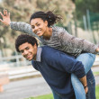 Mixed-Race Couple, Piggyback — Stock Photo #44123241