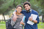 Mixed-Race Student Couple Outdoor — Stock Photo