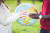 Multiracial Teen Couple Holding Globe Map — Stock Photo