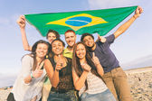 Friends with Brazilian Flag at Beach — Stock Photo