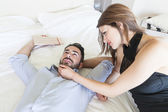 Tired Couple Lying on Bed — Stock Photo