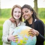 Multiracial Girls Holding Globe Map — Stock Photo #45347831