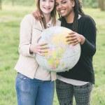 Multiracial Girls Holding Globe Map — Stock Photo #45347847