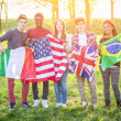 Teenage Friends Holding Flags from different Countries — Stock Photo #45347879