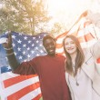 Multiracial Couple Holding American Flag — Stock Photo #45347901