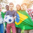 Teenage Friends Holding Brazilian Flag and Soccer Ball — Stock Photo #45347929