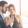 Elegant Young Couple Cheering at Hotel Suite — Stock Photo #45442687