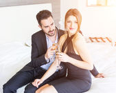 Elegant Young Couple Cheering at Hotel Suite — Stock Photo