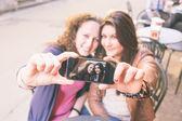 Girls Taking Selfie Seated at Bar — Stock Photo