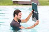 Man with Computer in the Swimming Pool — Stock Photo