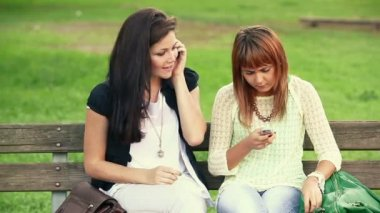 Two Young Women with Mobile Phone — 图库视频影像