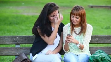 Two Young Women with Mobile Phone — Vídeo Stock