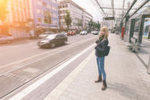 Girl waiting for tram — Foto Stock