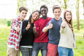 Teenagers with Thumbs Up — Stock Photo
