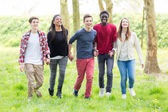 Teenagers holding by hands — Stock Photo